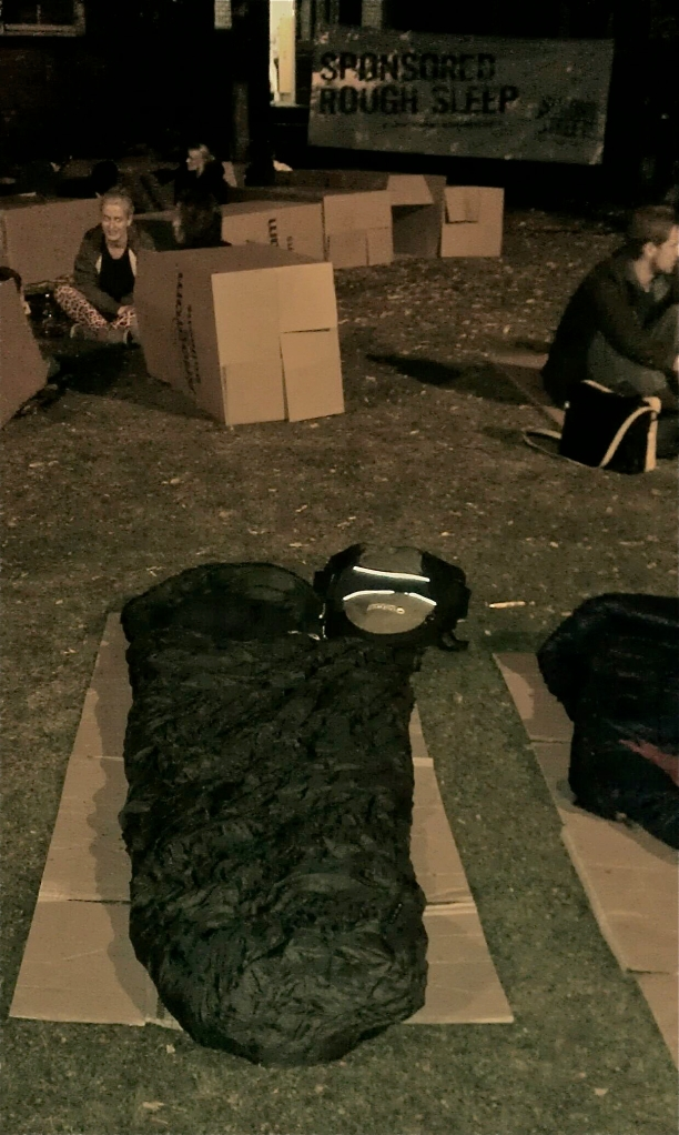 Rough sleeper bed of cardboard and sleeping bag