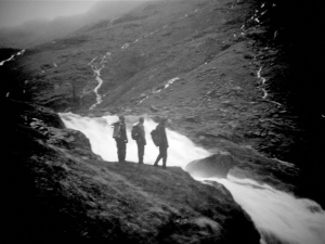 photo shoing hikers Looking into the white waters of Styhead Gill