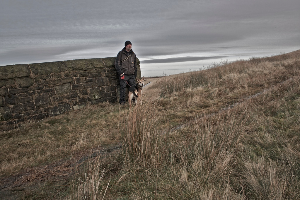 Walker and dog on marsden moor